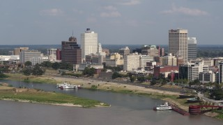 DX0002_183_025 - 5.7K stock footage aerial video of orbiting city buildings between office towers, Downtown Memphis, Tennessee