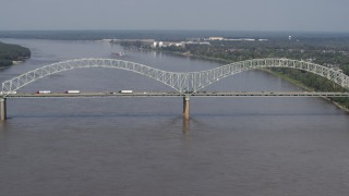 DX0002_183_028 - 5.7K stock footage aerial video slowly orbit the Hernando de Soto Bridge as traffic crosses the span, Memphis, Tennessee