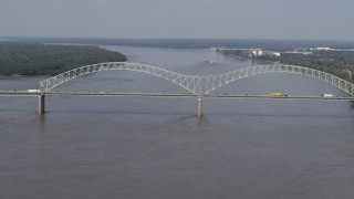 DX0002_183_029 - 5.7K stock footage aerial video reverse view of the Hernando de Soto Bridge as traffic crosses the span, Memphis, Tennessee