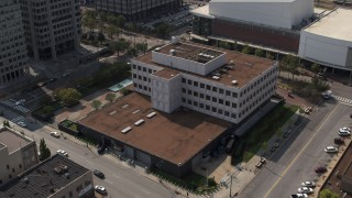 DX0002_183_036 - 5.7K stock footage aerial video ascend and descend while focused on the Federal Reserve Bank in Downtown Memphis, Tennessee