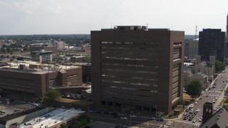 DX0002_184_005 - 5.7K stock footage aerial video of flying away from the county courthouse in Downtown Memphis, Tennessee