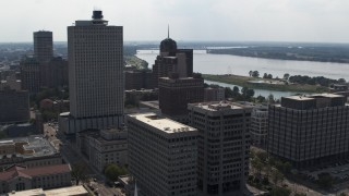 DX0002_184_013 - 5.7K stock footage aerial video reverse view of office high-rise, a county building and police station in Downtown Memphis, Tennessee