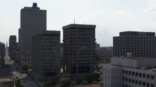DX0002_184_015 - 5.7K stock footage aerial video descend by a county building and police station in Downtown Memphis, Tennessee