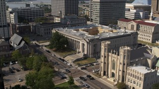 DX0002_184_022 - 5.7K stock footage aerial video flying away from courthouse and church in Downtown Memphis, Tennessee
