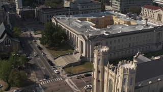 DX0002_184_027 - 5.7K stock footage aerial video focus on courthouse and descend by church in Downtown Memphis, Tennessee