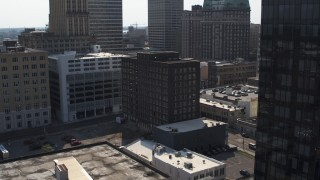 DX0002_184_032 - 5.7K stock footage aerial video orbit office building and flying close to courthouse, Downtown Memphis, Tennessee
