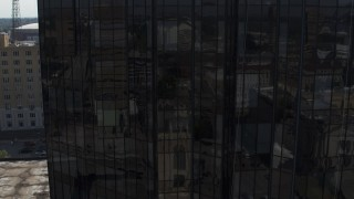 DX0002_184_033 - 5.7K stock footage aerial video flying close to courthouse and reveal office building, Downtown Memphis, Tennessee