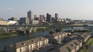 DX0002_185_003 - 5.7K stock footage aerial video of the city's skyline and bridge seen from apartment buildings, Downtown Memphis, Tennessee