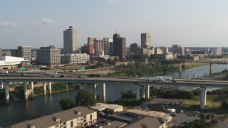 DX0002_185_004 - 5.7K stock footage aerial video ascend from apartment buildings to focus on skyline, Downtown Memphis, Tennessee