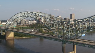 DX0002_185_006 - 5.7K stock footage aerial video ascend as traffic crosses the bridge near Downtown Memphis, Tennessee