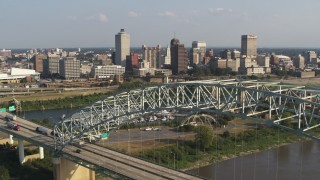 DX0002_185_011 - 5.7K stock footage aerial video ascend past bridge for view of the skyline, Downtown Memphis, Tennessee