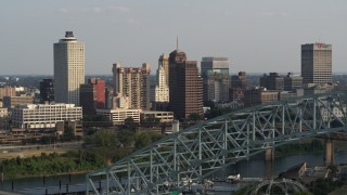 DX0002_185_021 - 5.7K stock footage aerial video of the skyline seen while flying by the bridge at sunset, Downtown Memphis, Tennessee