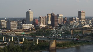 DX0002_185_030 - 5.7K stock footage aerial video of approaching the skyline behind the bridge at sunset, Downtown Memphis, Tennessee