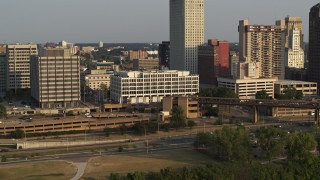 DX0002_185_042 - 5.7K stock footage aerial video focus on Memphis City Hall during descent at sunset, Downtown Memphis, Tennessee