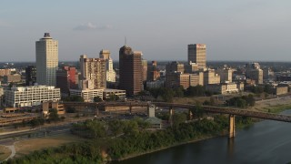 DX0002_186_006 - 5.7K stock footage aerial video of circling the downtown skyline at sunset, Downtown Memphis, Tennessee