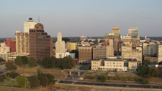DX0002_186_009 - 5.7K stock footage aerial video orbit Raymond James Tower and city buildings at sunset, Downtown Memphis, Tennessee