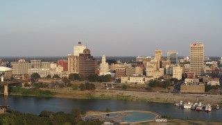 DX0002_186_010 - 5.7K stock footage aerial video fly away from Raymond James Tower for wider view of skyline at sunset, Downtown Memphis, Tennessee