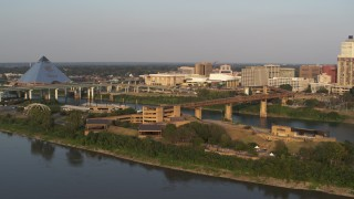 DX0002_186_013 - 5.7K stock footage aerial video orbit and approach museum at sunset, Downtown Memphis, Tennessee