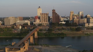 DX0002_186_023 - 5.7K stock footage aerial video of the welcome center, bridge, apartment complex and office tower at sunset, Downtown Memphis, Tennessee