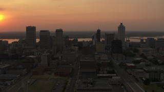 DX0002_186_025 - 5.7K stock footage aerial video orbit the city skyline and reveal setting sun, Downtown Memphis, Tennessee