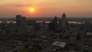 DX0002_186_027 - 5.7K stock footage aerial video orbit the downtown skyline and the setting sun, Downtown Memphis, Tennessee