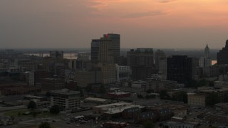 DX0002_186_034 - 5.7K stock footage aerial video of office high-rises with the setting sun in the sky, Downtown Memphis, Tennessee