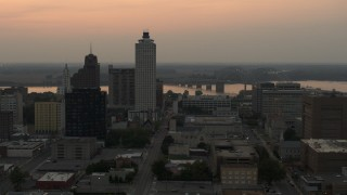 DX0002_186_037 - 5.7K stock footage aerial video flyby office towers at sunset, with view of river and bridge, Downtown Memphis, Tennessee