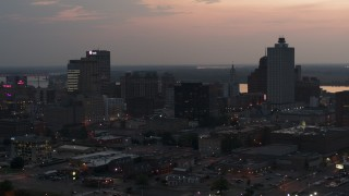 DX0002_187_003 - 5.7K stock footage aerial video of a reverse view of the city's downtown skyline at twilight, Downtown Memphis, Tennessee
