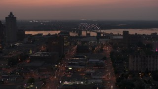 DX0002_187_008 - 5.7K stock footage aerial video orbit Hernando de Soto Bridge, seen from Downtown Memphis, Tennessee at twilight