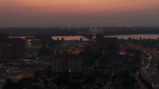 DX0002_187_011 - 5.7K stock footage aerial video a view of the Hernando de Soto Bridge, seen from Downtown Memphis, Tennessee at twilight