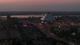 DX0002_187_013 - 5.7K stock footage aerial video of orbiting the Memphis Pyramid at twilight, Downtown Memphis, Tennessee