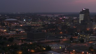 DX0002_187_015 - 5.7K stock footage aerial video of AutoZone Park baseball stadium at twilight, Downtown Memphis, Tennessee