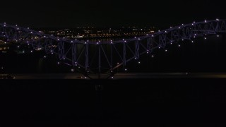 DX0002_187_031 - 5.7K stock footage aerial video of an orbit of the bridge with purple lights at night, Memphis, Tennessee