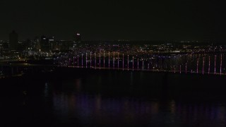 DX0002_187_047 - 5.7K stock footage aerial video slowly fly to the bridge with colorful lights and skyline at night, Downtown Memphis, Tennessee