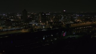 DX0002_187_053 - 5.7K stock footage aerial video of passing lights on the bridge at night to reveal Downtown Memphis, Tennessee