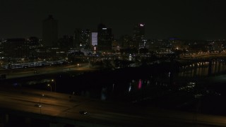 DX0002_187_054 - 5.7K stock footage aerial video view of the skyline while descending near the bridge at night, Downtown Memphis, Tennessee