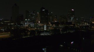 DX0002_187_055 - 5.7K stock footage aerial video ascend toward skyline and welcome center at night, Downtown Memphis, Tennessee
