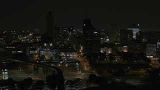 DX0002_187_056 - 5.7K stock footage aerial video orbit apartment and office high-rises at night, Downtown Memphis, Tennessee