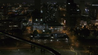 DX0002_187_065 - 5.7K stock footage aerial video approaching apartment high-rise and parking garage at night, Downtown Memphis, Tennessee