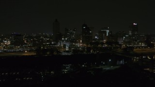 DX0002_187_070 - 5.7K stock footage aerial video of the city's downtown skyline at nighttime while descending, Downtown Memphis, Tennessee