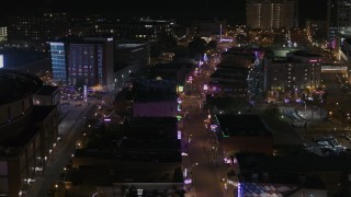 DX0002_188_001 - 5.7K stock footage aerial video of flying by Beale Street at nighttime, Downtown Memphis, Tennessee
