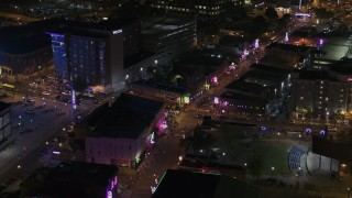 DX0002_188_006 - 5.7K stock footage aerial video of bright lights and signs down Beale Street at nighttime, Downtown Memphis, Tennessee