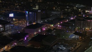 DX0002_188_007 - 5.7K stock footage aerial video of flying by bright lights and signs on Beale Street at nighttime, Downtown Memphis, Tennessee