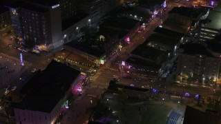 DX0002_188_014 - 5.7K stock footage aerial video a busy Beale Street intersection at nighttime, Downtown Memphis, Tennessee