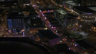DX0002_188_016 - 5.7K stock footage aerial video of busy Beale Street at nighttime, Downtown Memphis, Tennessee