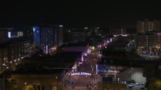 DX0002_188_019 - 5.7K stock footage aerial video of passing by busy Beale Street at nighttime, Downtown Memphis, Tennessee