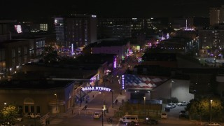 DX0002_188_020 - 5.7K stock footage aerial video of flying by the Beale Street sign at nighttime, Downtown Memphis, Tennessee