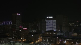 DX0002_188_024 - 5.7K stock footage aerial video of a reverse view of an office tower at nighttime, Downtown Memphis, Tennessee