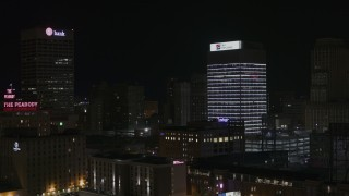 DX0002_188_026 - 5.7K stock footage aerial video of fly away from First Tennessee Building at nighttime and descend, Downtown Memphis, Tennessee
