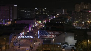 DX0002_188_033 - 5.7K stock footage aerial video of passing the Beale Street sign at nighttime, Downtown Memphis, Tennessee